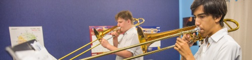 students playing trombones